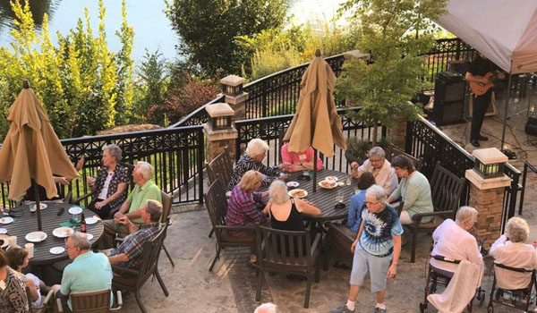 Residents enjoying the patio at GIvens Estates